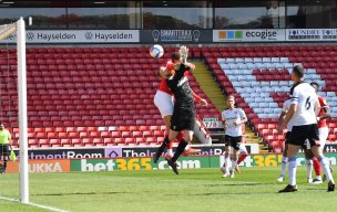 Main image for Reds on brink of play-offs after edging derby