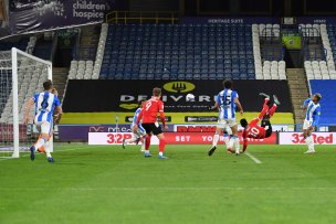 Main image for Dike overhead kick secures win for dominant Reds