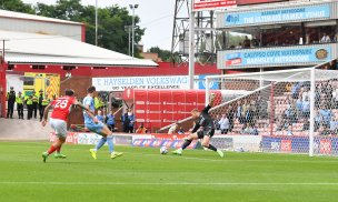 Main image for Collins saves last-gasp penalty as fans return with victory