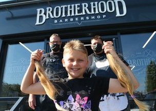 Main image for Ten-year-old chops locks for charity