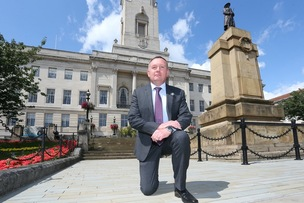 Main image for Councillor takes the knee at meeting