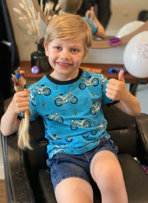 Main image for Selfless seven-year-old raises cash for cancer-stricken kids