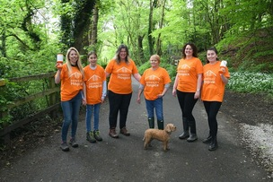 Main image for Law firm staff help boost hospice's coffers