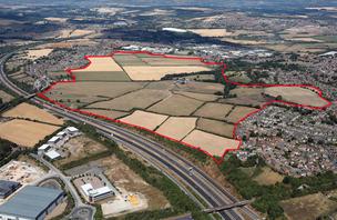 Main image for Plans for 1,760 homes on former green belt site break cover