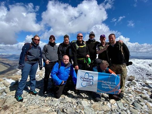 Main image for Bus drivers climb mountain for charity